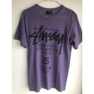 ステューシー(STUSSY)の【定番】stussy ワールドツアーTシャツ 紫(Tシャツ/カットソー(半袖/袖なし))