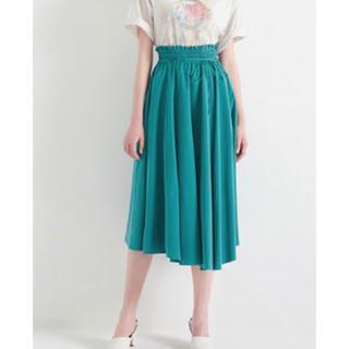 ミラオーウェン(Mila Owen)の《新品タグ付き》ミラオーウェン アシンメトリーヘムフレア巻きスカート(ロングスカート)