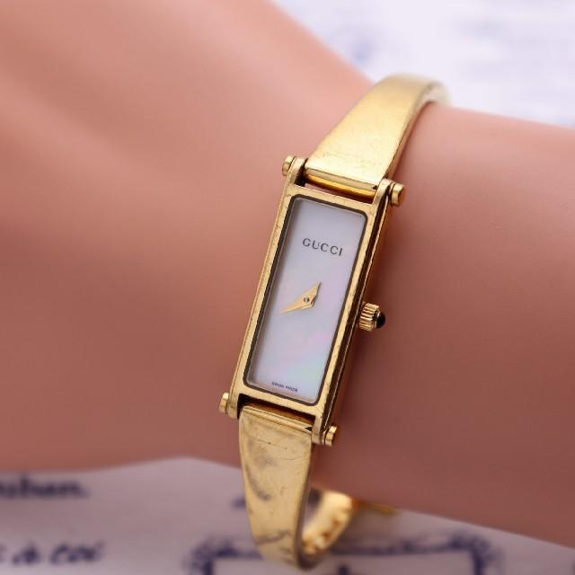 Gucci(グッチ)の正規品【新品電池】GUCCI 1500L/ホワイトシェル バングル 定番 レディースのファッション小物(腕時計)の商品写真
