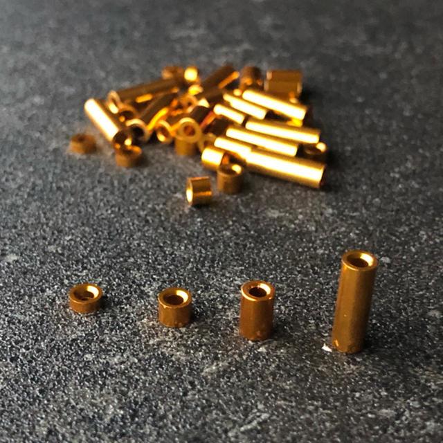ミニ四駆 アルミスペーサーセット オレンジ エンタメ/ホビーのおもちゃ/ぬいぐるみ(模型/プラモデル)の商品写真