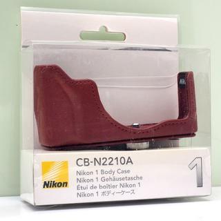 ニコン(Nikon)のNikon1 J4 / S2 用 純正 ボディケース CB-N2210A 赤(ケース/バッグ)