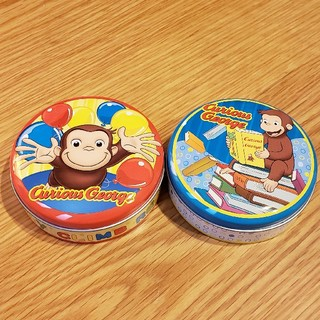 ユニバーサルエンターテインメント(UNIVERSAL ENTERTAINMENT)のおさるのジョージ 缶 2個セット(キャラクターグッズ)