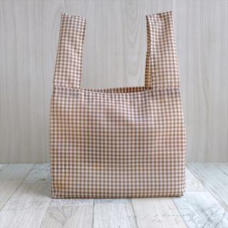 コンビニで使える小さめレジ袋型エコバッグ・茶チェック足跡タグ(バッグ)