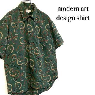 ステファノバレンチノ(STEFANO VALENTINO)の美品 モダンアート 古着 総柄 デザインポリシャツ メンズL グリーン(シャツ)