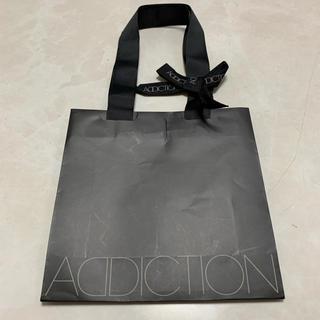 アディクション(ADDICTION)のアディクション ショッパー ギフト リボン付き(ショップ袋)