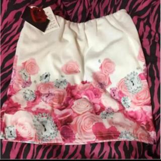 ダチュラ(DaTuRa)のDaTuRaダチュラ 新品 スカート タグ付き バラ柄 ホワイト 白(ミニスカート)