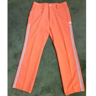 アディダス(adidas)のアディダスゴルフパンツW79 オレンジ(スラックス)