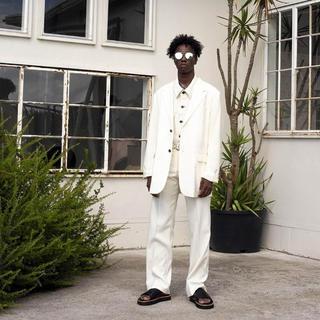 アンユーズド(UNUSED)のDAIRIKU Flasher Pressed Pants white(スラックス)