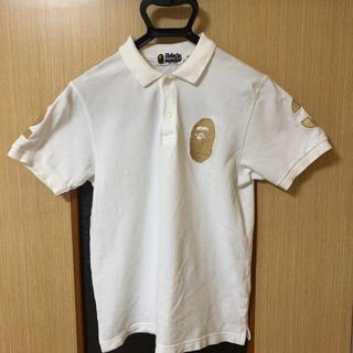 アベイシングエイプ(A BATHING APE)のアベイシングエイプ APE ポロシャツ 23周年 ゴールド ホワイト S(ポロシャツ)