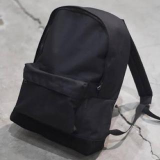 コモリ(COMOLI)の希少 comoli デイパック ブラック コモリ(バッグパック/リュック)