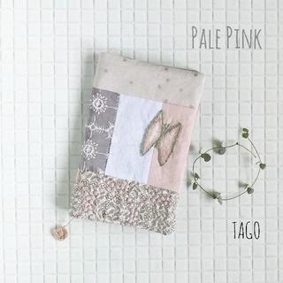 ミナペルホネン(mina perhonen)の新書サイズ 淡いピンクのブックカバー ミナペルホネン ハンドメイド(ブックカバー)