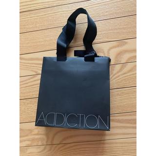 アディクション(ADDICTION)のaddiction 紙袋(ショップ袋)