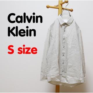 カルバンクライン(Calvin Klein)のカルバンクライン シャツ 長袖 総柄 アート デザイン ベージュ OLD 古着(シャツ)