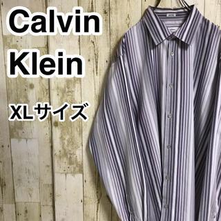 カルバンクライン(Calvin Klein)のカルバンクライン 長袖シャツ XL パープル 縦ストライプ ロゴボタン(シャツ)