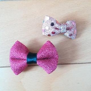 スピンズ(SPINNS)のピンクのリボンヘアクリップ2点セット(バレッタ/ヘアクリップ)