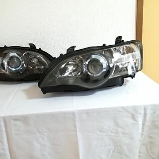 スバル(スバル)の本日限定 レンズ再生 車検OK レガシィ  BP5 BL5 純正 HID(車種別パーツ)