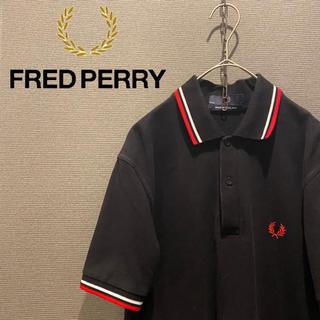 フレッドペリー(FRED PERRY)のフレッドペリー メンズ ポロシャツ 黒 古着 イングランド製(ポロシャツ)
