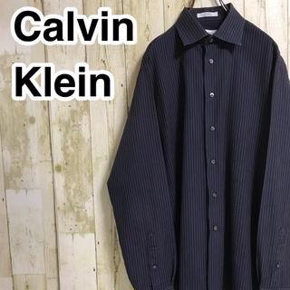 カルバンクライン(Calvin Klein)のカルバンクライン 長袖シャツ ネイビー 縦ストライプ ゆるダボ(シャツ)