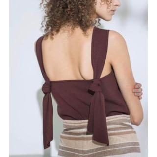 ミラオーウェン(Mila Owen)のバックリボンニットトップス(カットソー(半袖/袖なし))