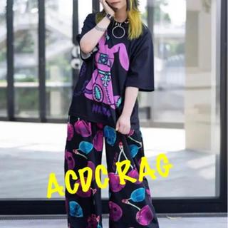 エーシーディーシーラグ(ACDC RAG)のACDC RAG ネロ Tシャツ 原宿系 原宿 韓国 黒 紫 病みかわ(Tシャツ(半袖/袖なし))