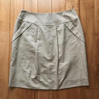 イッカ(ikka)の新品未使用タグ付き ikka ベージュスカート(ひざ丈スカート)