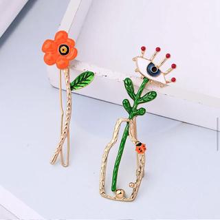 アネモネ(Ane Mone)の花と目ブローチ ヘアピン アクセサリー オレンジ(ヘアアクセサリー)