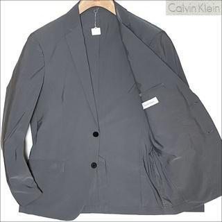 カルバンクライン(Calvin Klein)のJ5125 美品 カルバンクライン トラベル アンコンジャケット 灰 38(テーラードジャケット)
