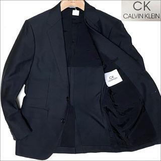 カルバンクライン(Calvin Klein)のJ4058 美品 カルバンクライン バーズアイ ウールテーラードジャケット紺36(テーラードジャケット)