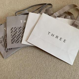 スリー(THREE)の美品!THREE ショッパー ショップ袋(ショップ袋)