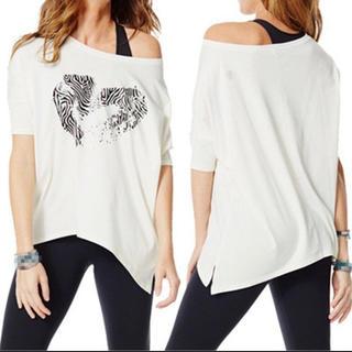 ズンバ(Zumba)の【新品未使用】ZUNBA ズンバ Tシャツ ハート♡白 L(Tシャツ(半袖/袖なし))