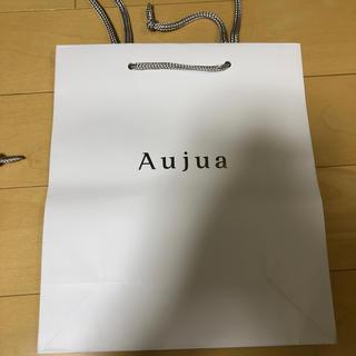 オージュア(Aujua)のミルボン 紙袋 新品未使用(ショップ袋)
