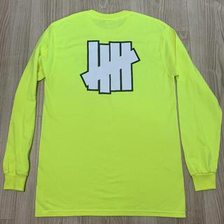 アンディフィーテッド(UNDEFEATED)のUNDEFEATED イエロー ロンT(Tシャツ/カットソー(七分/長袖))
