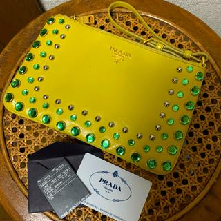 プラダ(PRADA)のPRADA ビジュー付きエナメルクラッチバッグ 直営店購入(クラッチバッグ)