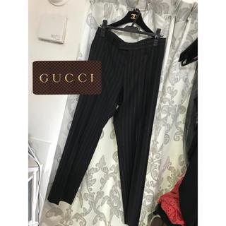 グッチ(Gucci)のGUCCI   黒 ストライプ スラックス パンツ(スラックス)