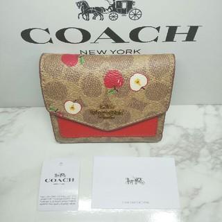 COACH - COACH PVC、ペブルレザ-/チョーク×フローラル 三つ折り財布 87709