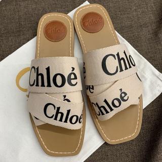 クロエ(Chloe)のクロエ サンダル ホワイト キャンバス製「Woody」フラットミュール(サンダル)