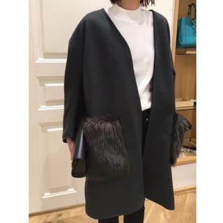 ミラオーウェン(Mila Owen)の新品タグ付き ミラオーウェン エコファーポケット付コート(ロングコート)