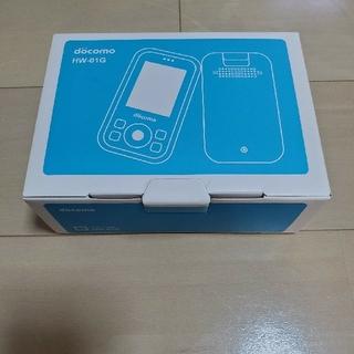 エヌティティドコモ(NTTdocomo)のDOCOMO キッズ携帯 箱ありHW-01G ワンピースカバー付き(携帯電話本体)