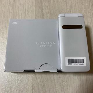 エーユー(au)のGRATINA KYF37SWA WHITE 新品未使用 SIMロック解除済み(携帯電話本体)