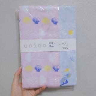 ウニコ(unico)の【新品未使用】unico ピローケース 貝やクラゲの海柄(シーツ/カバー)