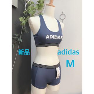 アディダス(adidas)の新品 M ブルー アディダス ブラ ショーツ ハーフトップ スポーツブラ(ブラ&ショーツセット)