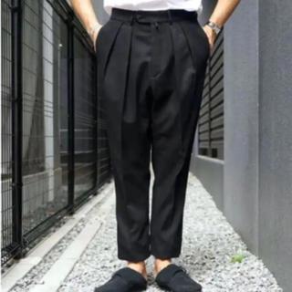 コモリ(COMOLI)のNEAT cotton kersey tapaerd black 44(スラックス)