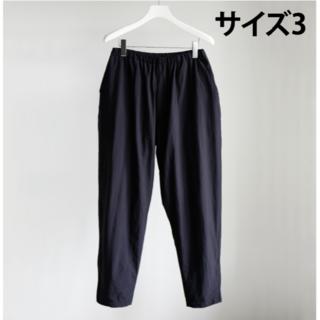 コモリ(COMOLI)のCOMOLI  20AW ナイロン TRACK PANTS NAVY サイズ3(その他)
