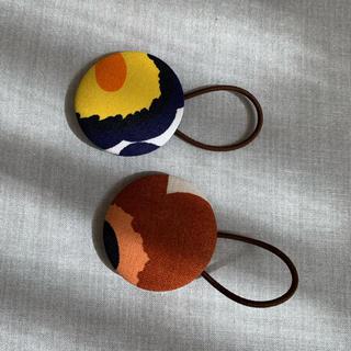 マリメッコ(marimekko)のマリメッコ ミニウニッコ くるみボタン2個セット(ヘアアクセサリー)