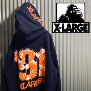 XLARGE - X-LARGE  パーカー 総柄 バックプリント