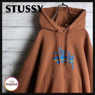 ステューシー(STUSSY)の【即完モデル‼︎】STUSSY◎茶 ストックロゴ 都市名 パーカー(パーカー)