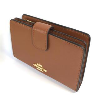 COACH - コーチCOACH新品、正規品ライトブラウンに所々にシグネチャー柄折り財布