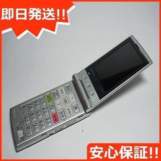 キョウセラ(京セラ)の良品中古 au K004 シルバー 白ロム(携帯電話本体)