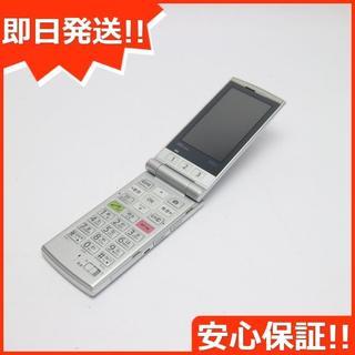 キョウセラ(京セラ)の美品 au K004 シルバー 白ロム(携帯電話本体)