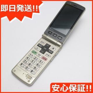 キョウセラ(京セラ)の良品中古 au K005 簡単ケータイ ゴールド 白ロム(携帯電話本体)